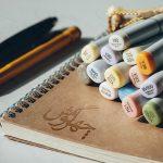موکاپ لوگو روی دفترچه طراحی و نقاشی